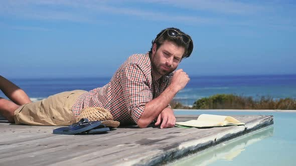 Thumbnail for Man lying down by pool