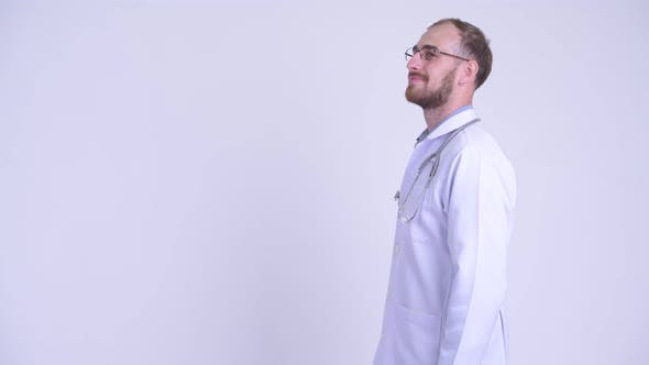 Thumbnail for Profile View of Happy Bearded Man Doctor Smiling