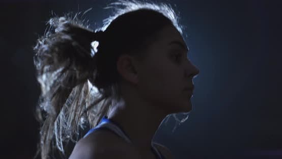 Thumbnail for Young Woman Boxer in Training in the Hall Jumping Rope Close-up