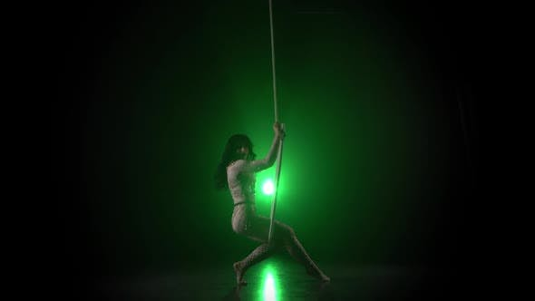 Thumbnail for Aerial Acrobat in the Ring A Young Girl Performs the Acrobatic Elements in the Air Ring on Green