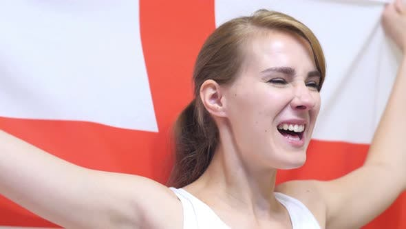 English Young Woman Celebrates Holding the Flag of England
