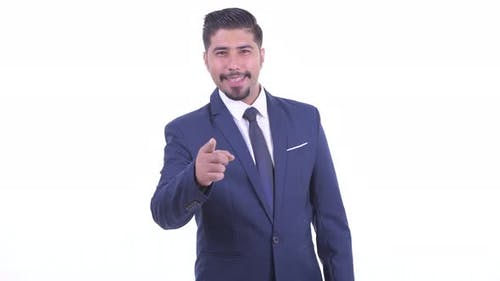 Happy Bearded Persian Businessman Pointing at Camera