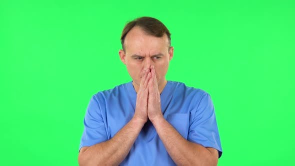Thumbnail for Medical Man Thinks About Something, and Then an Idea Comes To Him. Green Screen