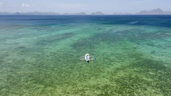 Thumbnail for Aerial Circle Footage of Filipino Boats Moored in Shallow Lagoon Bay Near El Nido Village. Bacuit