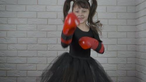 Happy Child in Sport Gloves