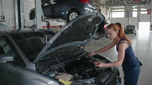 Thumbnail for Lady Mechanic Working in Car Service