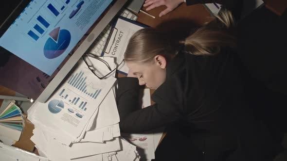 Thumbnail for Female Office Worker Sleeping on Desk