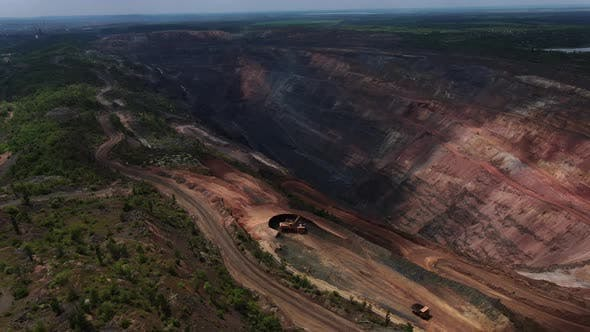 Drone View on the Heavy Machinery Around a Quarry