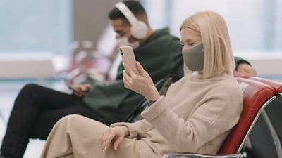 Woman Having Video Call In Departure Lounge