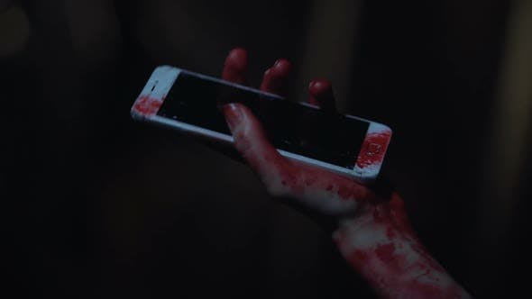 Thumbnail for Survivor of Car Accident Holding Broken Cellphone in Bloody Hand, Shocked Person