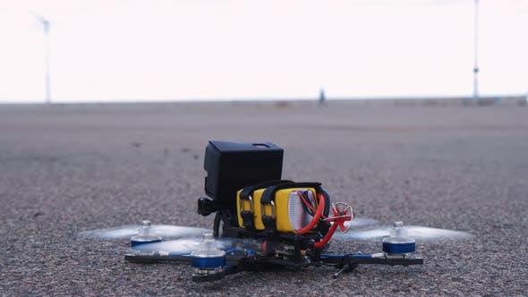 Thumbnail for FPV Racing Drone Takes Off From the Asphalt Surface