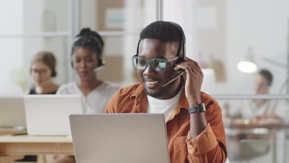 Thumbnail for Positive Afro-American Man Working in Call Center