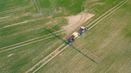 Aerial View of Tractor That Irrigates Field