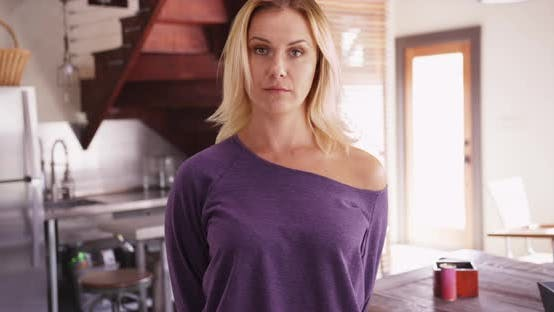 Thumbnail for Attractive woman smiling at camera in purple sweater