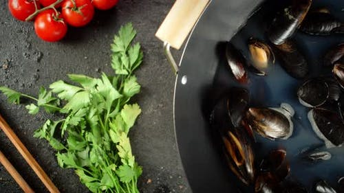 Cooking the Mussels in a Saucepan.