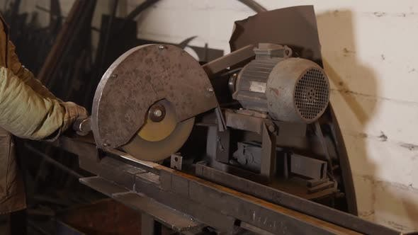 Thumbnail for Master Is Cutting Long Metal Detail By Powerful Industrial Circular Saw