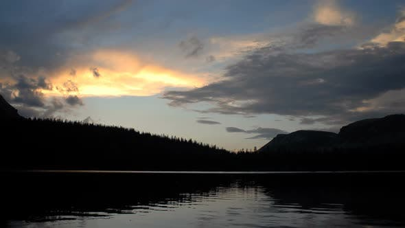 Thumbnail for Time-lapse of a mountain lake and clouds at sunset
