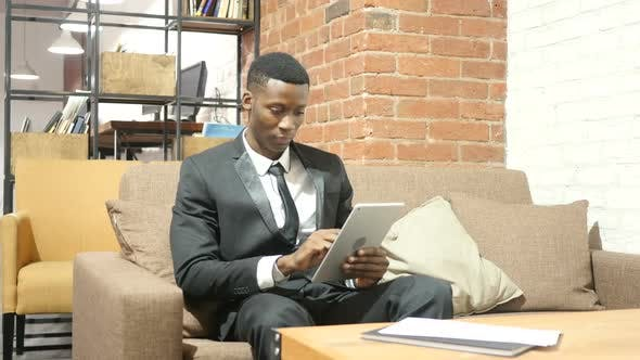 Black Businessman Using Tablet, Indoor