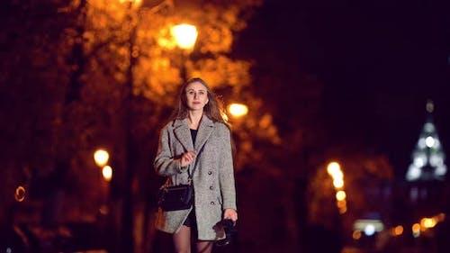 Happy Girl Walking in the Night Autumn City
