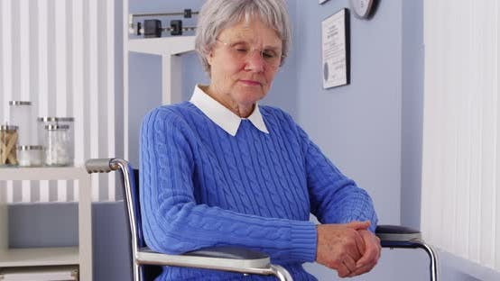 Thumbnail for Senior woman looking at camera in wheelchair