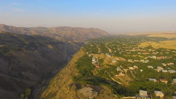 Cover Image for Wonderful Aerial View of Mountain Valley and Old Armenian Village on Sunny Day