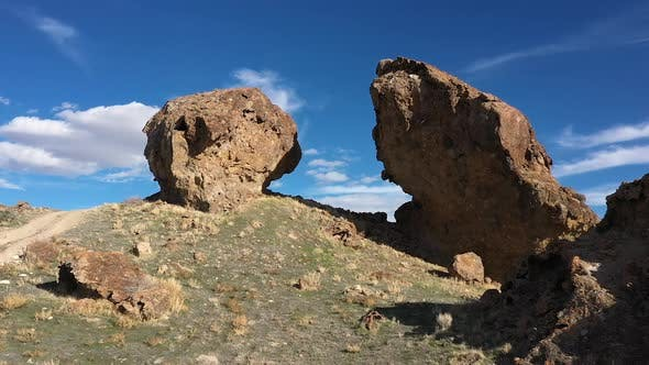 Thumbnail for Aerial flying up and through gap between boulders in the desert