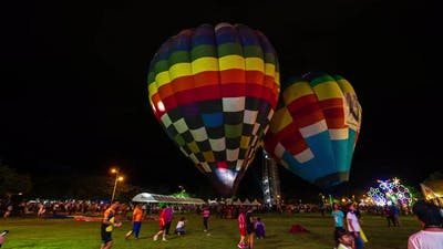 time lapse of Air balloons glow with burner flame glowing in night