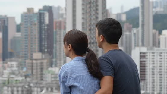 Cover Image for Couple look at the view of the city