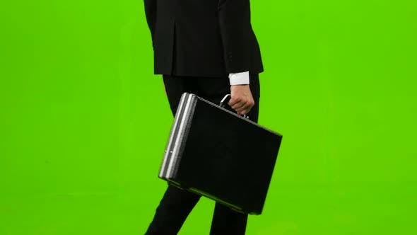 Thumbnail for Man Holds a Briefcase in His Hand, He Rushes Over It. Green Screen
