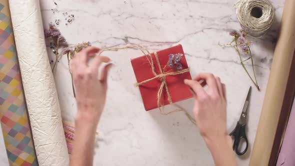 Thumbnail for Female Hands Unpacking Gift Box and Taking Perfume Bottle
