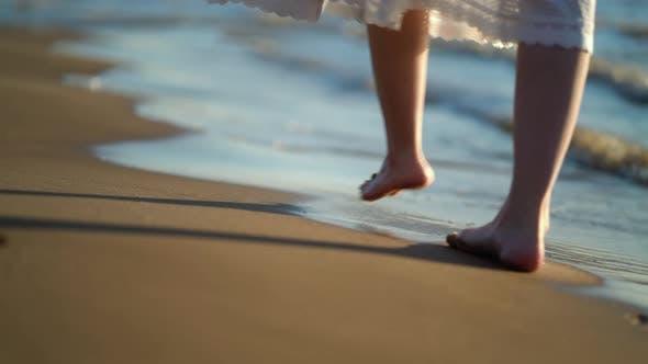 Pretty Woman Walks at Seaside Surf