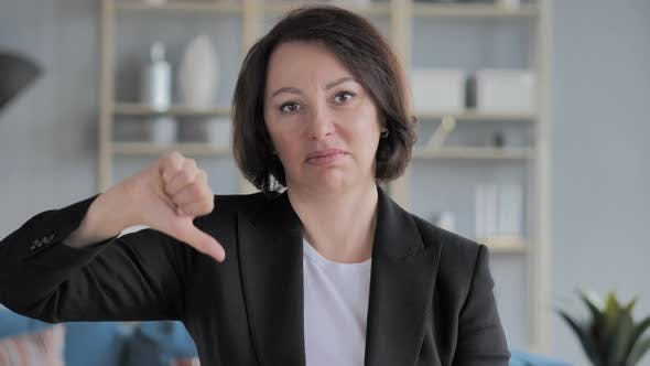 Thumbnail for Portrait of Old Businesswoman Gesturing Thumbs Down