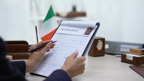 Embassy Employee Approving Visa Application, Italian Flag on Table, Government