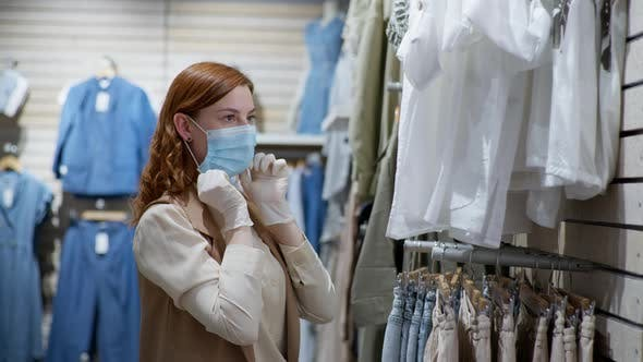 Thumbnail for Safe Shopping, Portrait of Beautiful Female Shopper with Medical Gloves Putting on Face Mask To