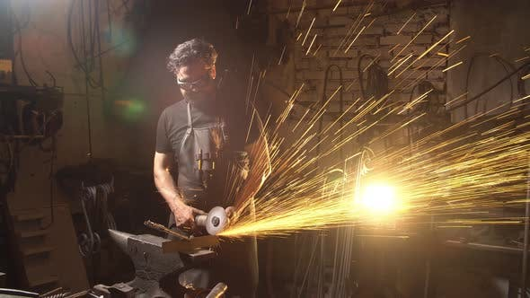 Thumbnail for Man Working the Angle Grinder in Workshop. Blacksmith Working with Metal