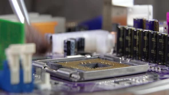 The Process of Cleaning and Installing a Processor on a Computer Motherboard