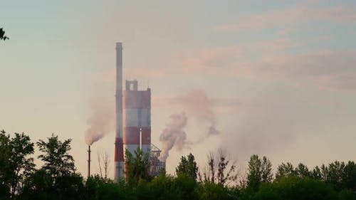 Factory chimneys pollution black thick smoke sky.  Air pollution and global warming climate change