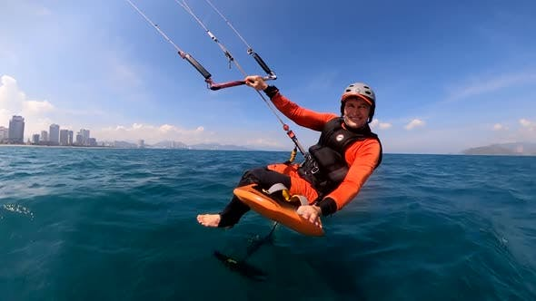 Athlete Showing Sport Trick Jumping with Kite and Board in Air. Extreme Water Sport and Summer