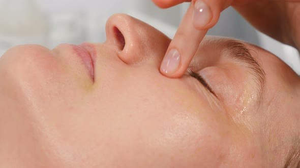 Beautician Doing Cure Procedures on Client Face in Cosmetology Clinic