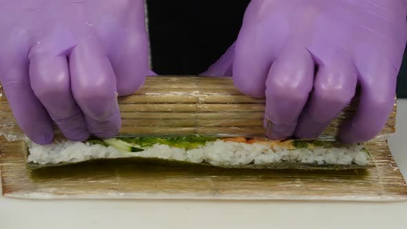 Thumbnail for Chef Uses a Bamboo Mat for Preparing Sushi. Close Up