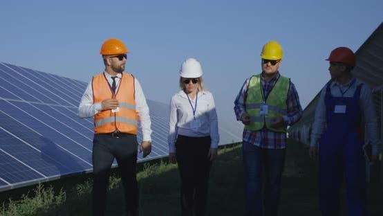 Electrical Workers Walking in a Solar Farm