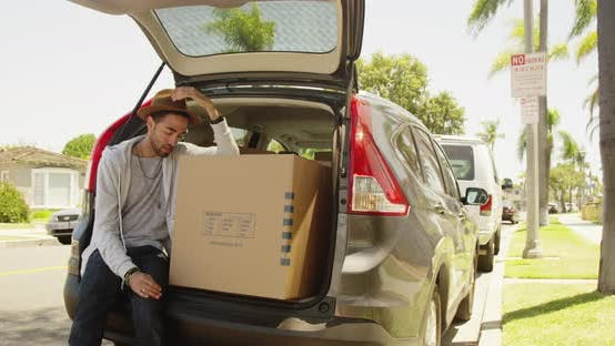 Thumbnail for hispanic man tired from moving boxes