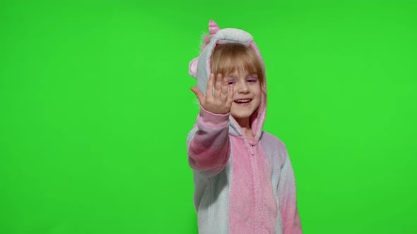 Thumbnail for Little Child Girl Smiling Pointing at Camera Making Gun Gesture with Hands in Unicorn Pajamas