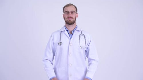 Happy Bearded Man Doctor Greeting with Respect