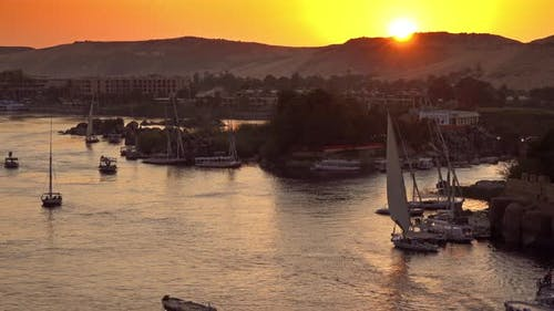 Felucca Boats on Nile River in Aswan at Sunset