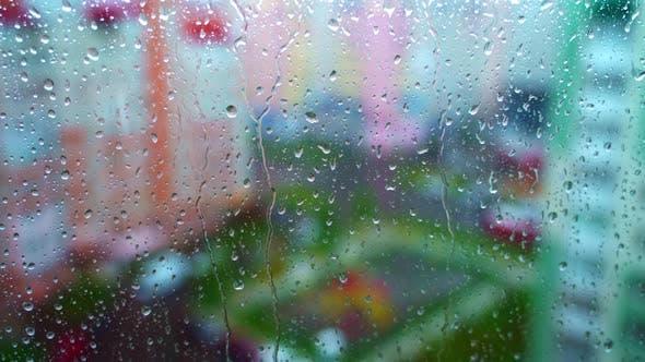 Window at rainy day on blur city background
