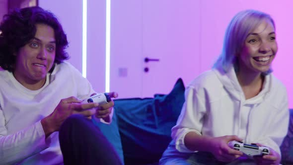 Thumbnail for Home Isolated Couple Push Shove Each Other As They Play Video Game Home