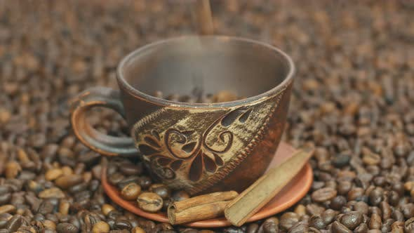 Thumbnail for Coffee Beans Poured Into A Beautiful Cup