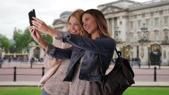 Thumbnail for Couple of attractive white females traveling in London take selfie on smartphone