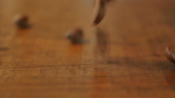 Thumbnail for Coffee Beans Are Falling on the Wooden Table